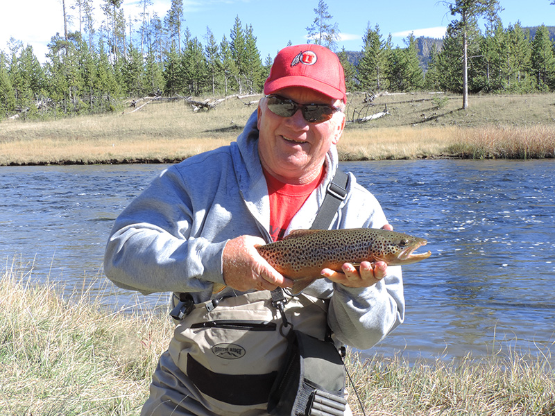 a fisherman with his catch seen on a Yellowstone family vacation