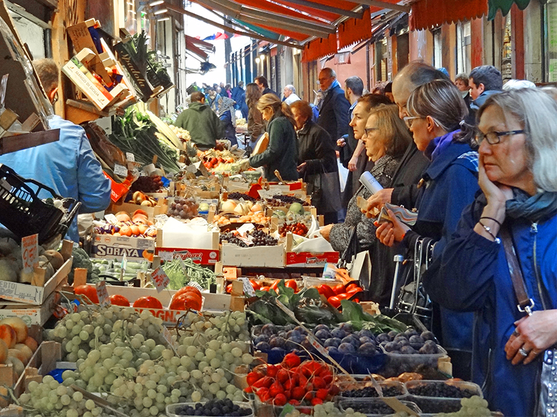 women in a vegetable market in Bologna