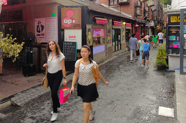 young women walking in the French Concession, one of the things to do in Shanghai
