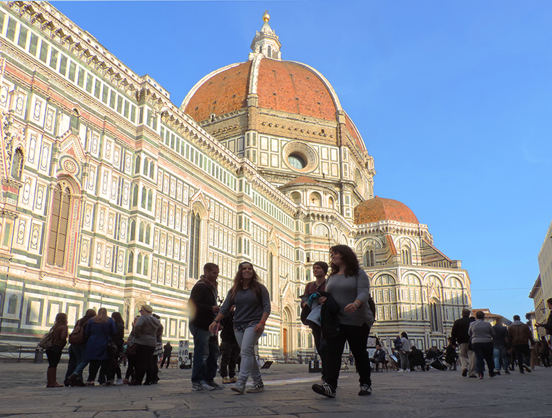 people walking past the Duomo in Florence, one of the top places to visit in Italy