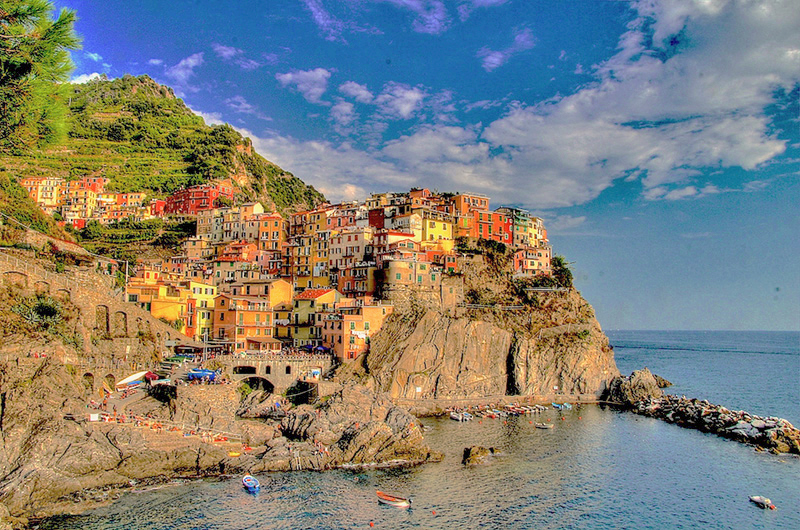 Cinque Terre at sunset, one of the top places to visit in Italy