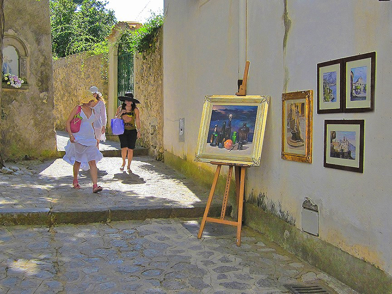 paintings hangin on a wall in Ravello, one of the top places to visit in Italy