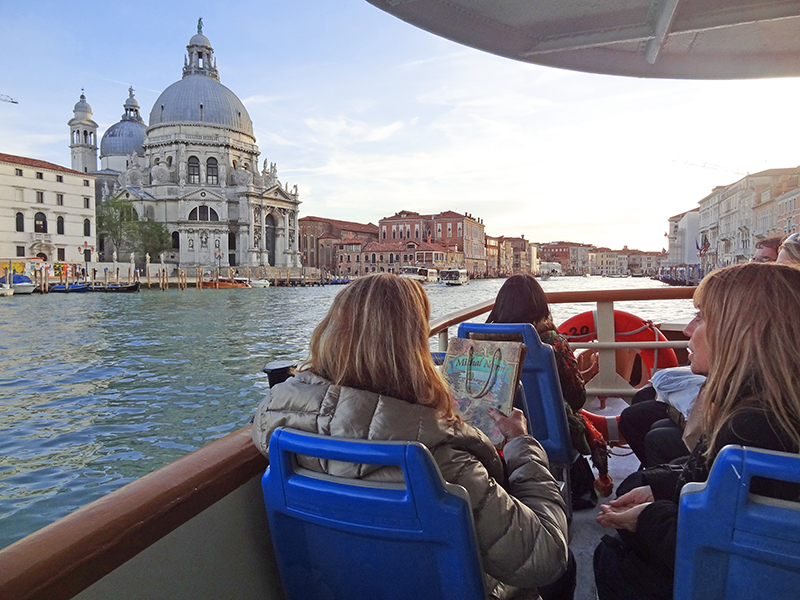 passengers aboard a vaporetto in Venice, , one of the top places to visit in Italy