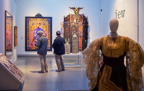 people looking at artwork
