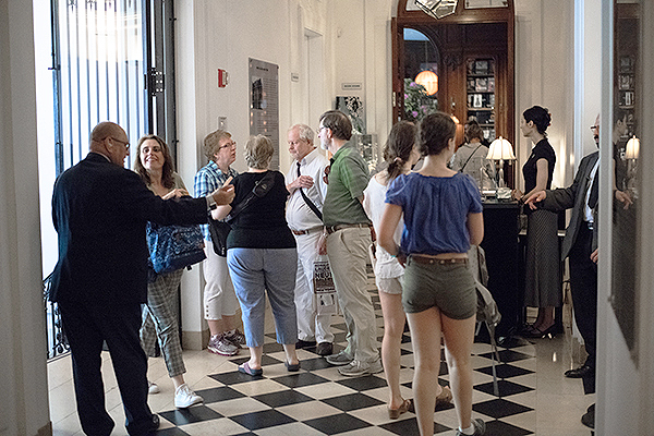 people in a foyer of a Museum