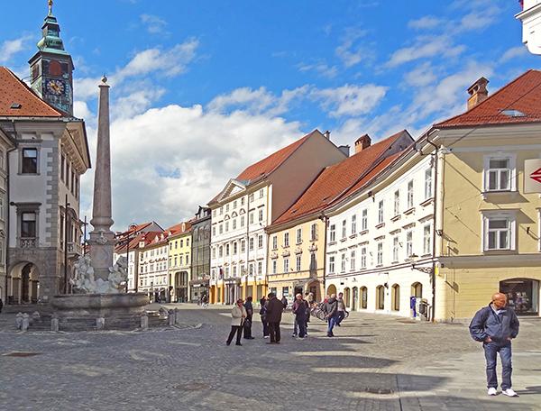 people walking through an old town