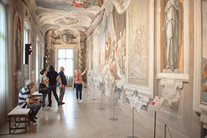 people looking at frescos in Friuli