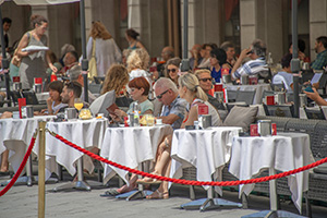 people in an outdoor cafe in Trieste