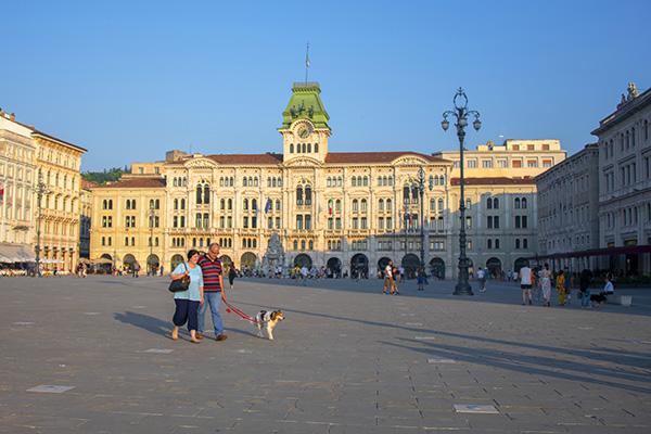 couple walking a dog in Trieste