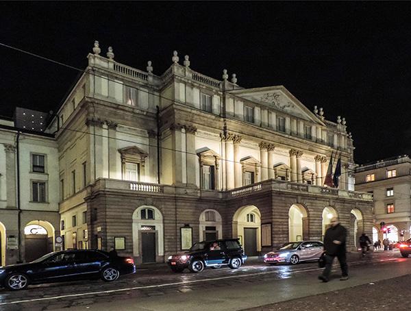people at an opera house at night