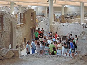 people on a Greece holiday in an archeological site