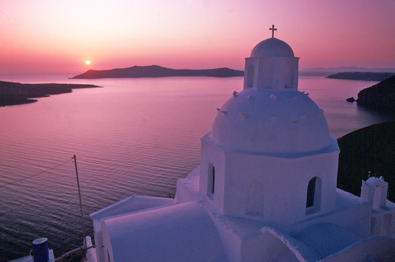 a church at sunset on one of the top Greek islands