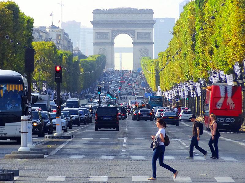 women crossing Champs-Élysées