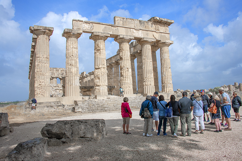 people looking at a greek temple - Mt. Etna