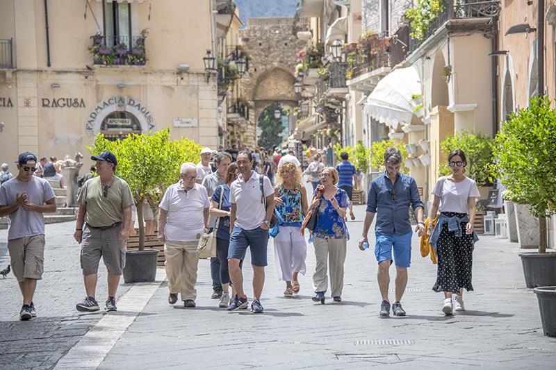people walking along a street - Mt. Etna
