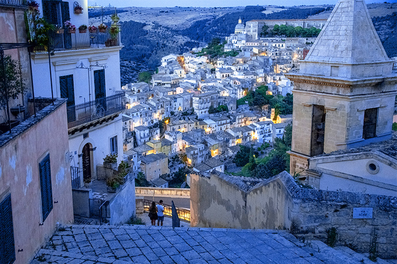 Sicily by car allows you to see ancient cities such as Ragusa at twilight