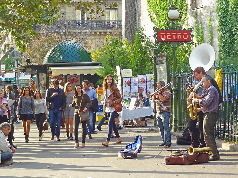 musicians on a busy sidewalk - seen on a walking tour of Paris