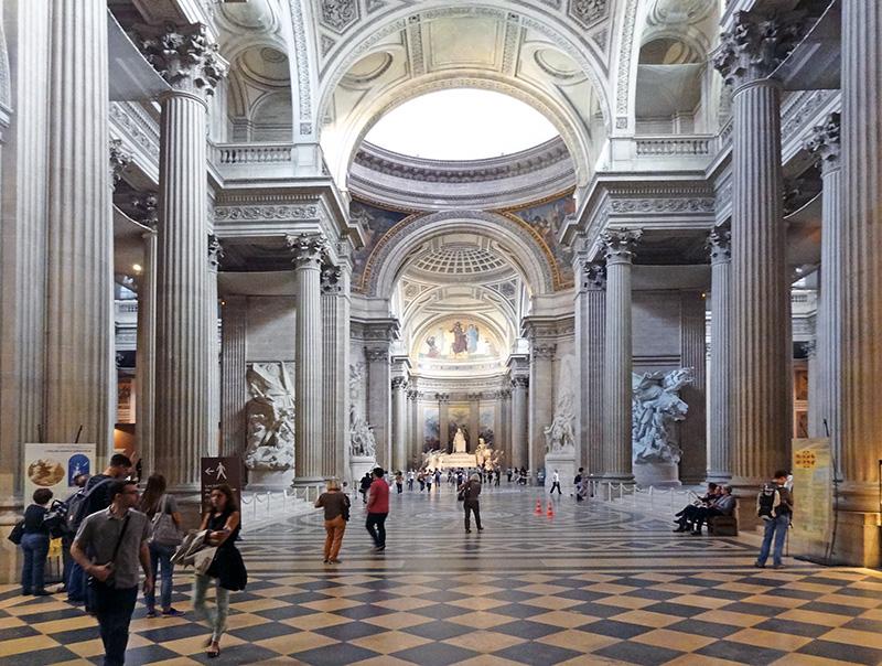 people walking through an ornate building - paris map