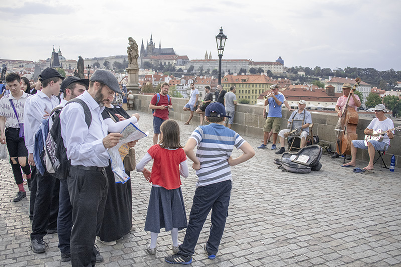 man looking at a map of Prague