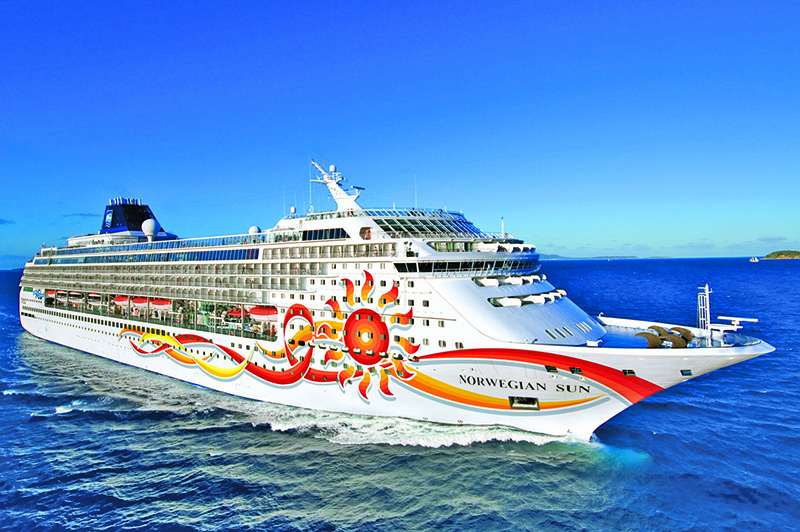 a cruise ship sailing off an island on a mini-cruise