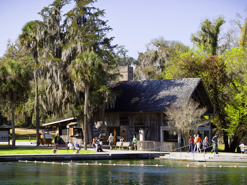 people sitting near a rustic building in Ponce De Leon Springs State Park. one of Florida's freshwater springs