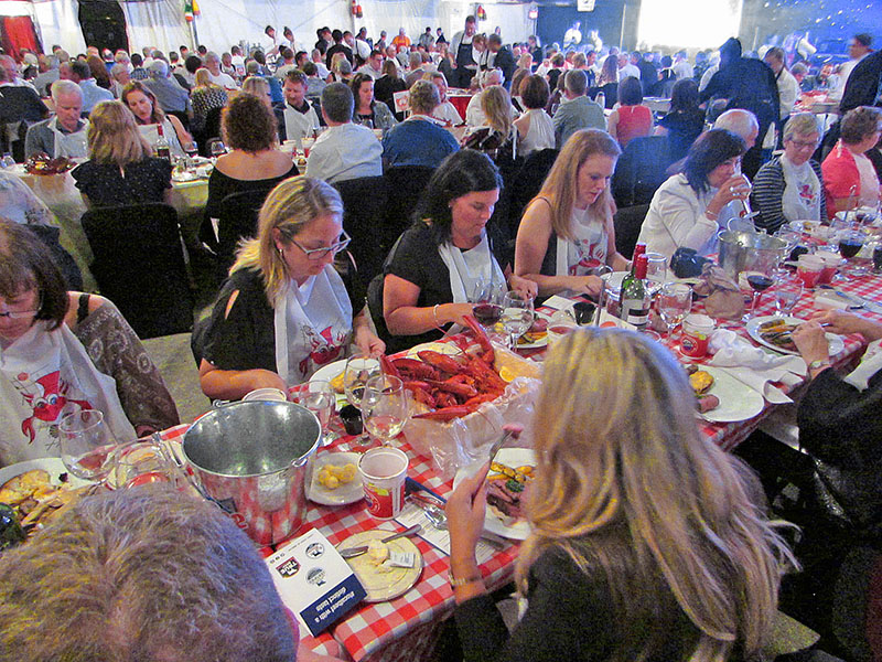 people dining on mussels and lobster