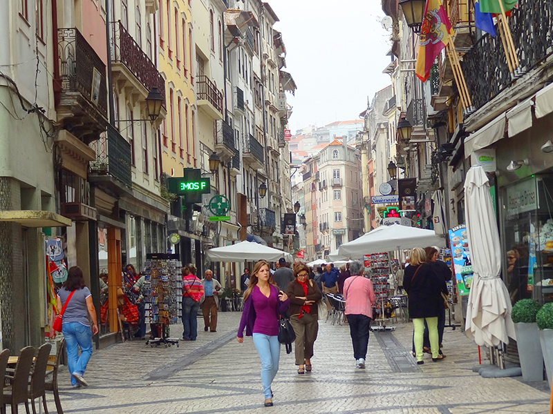 people on in the old city of Coimbra seen on a day trip from Lisbon