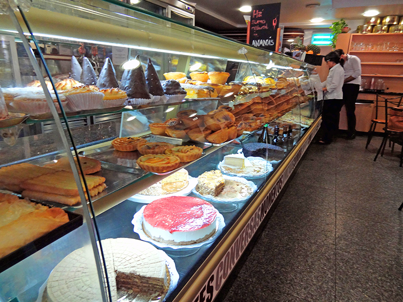 image of people in a pastry shop in Coimbra seen on a daytrip from Lisbon