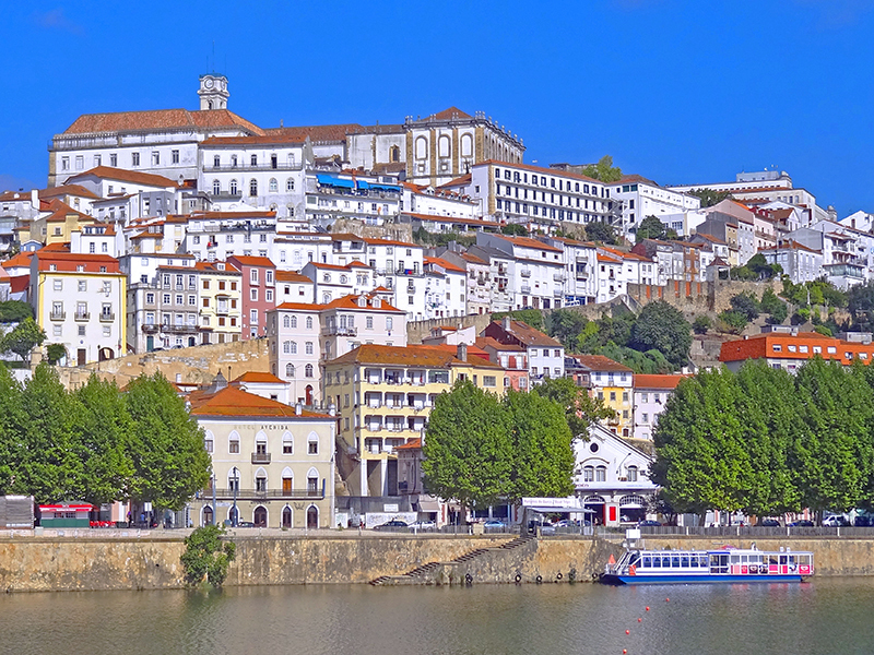 image of Coimbra, Portugal from across a ribver