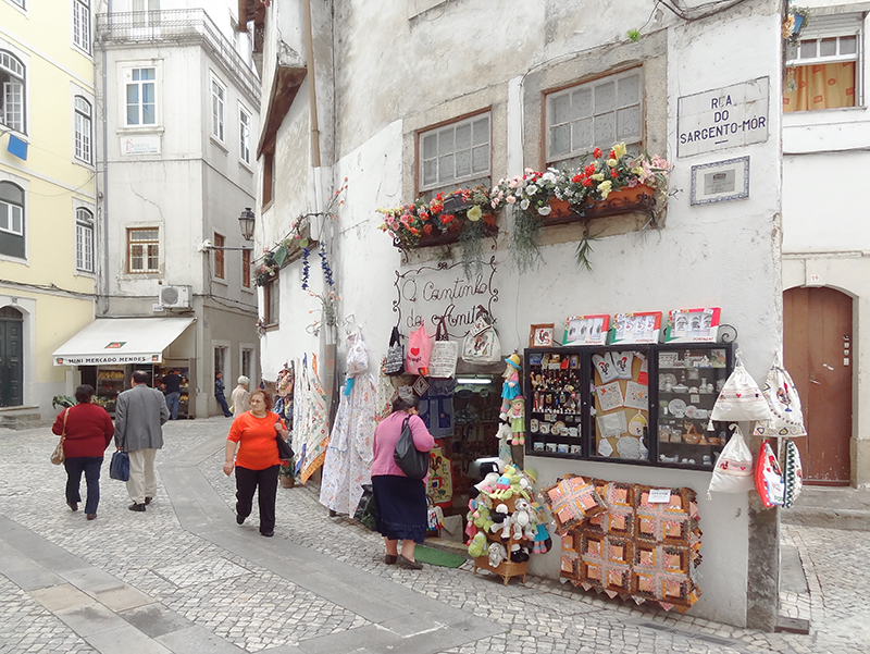 people walking into shops in Coimbra Portugal on a day trip from Lisbon