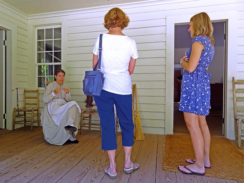three women talking on a porch