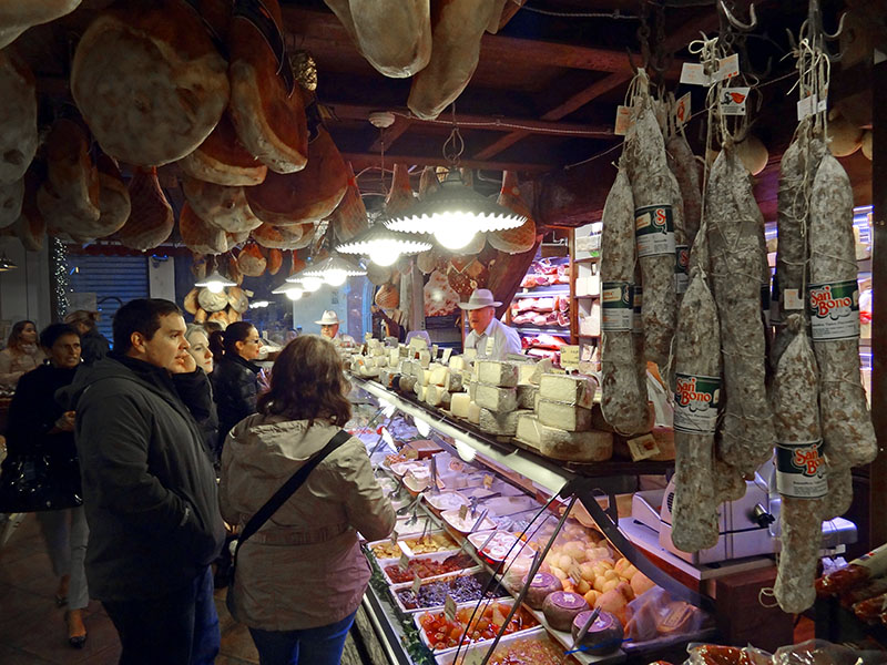 Shoppers standing by a food counter