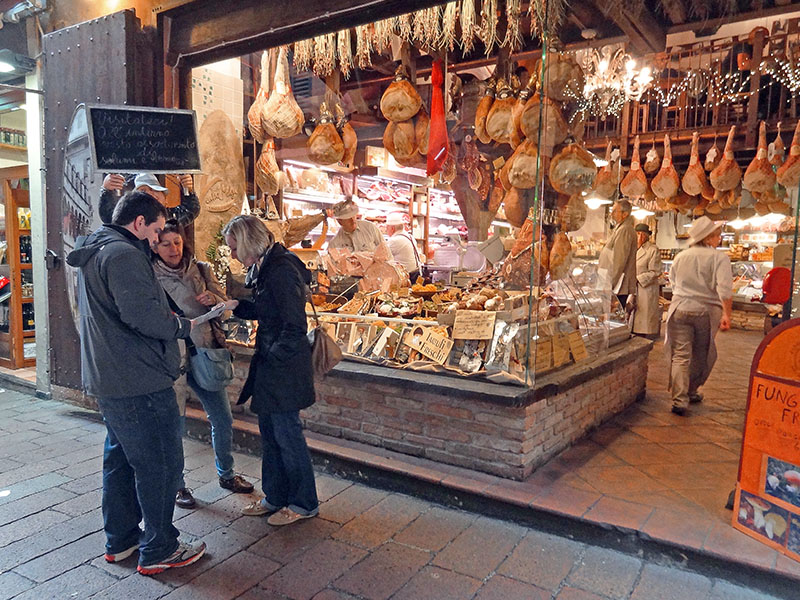people by a store selling Bologna food in the Quadrilatero
