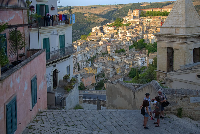 the fascinating experience of viewing a Sicilian hill town at sunset