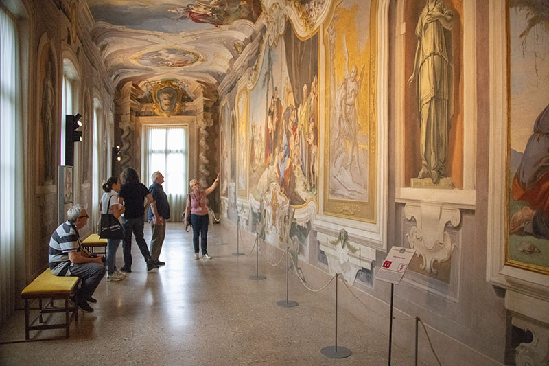 people in a museum in Udine, one of the best travel experiences to have in Italy