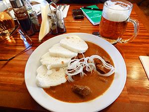 a bowl of dumplings in one of the best restaurants in Prague