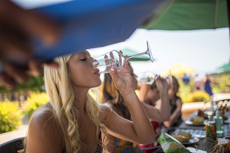 a woman on a wine tour in Santa Barbara drinking a glass of wine
