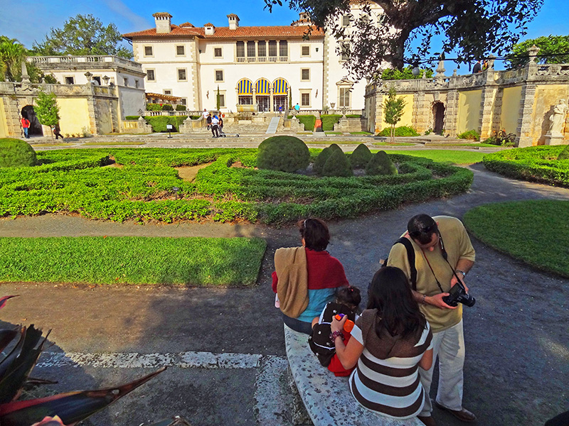 people in a garden at the Vizcaya Museum and Gardens, one of Miami's attractions