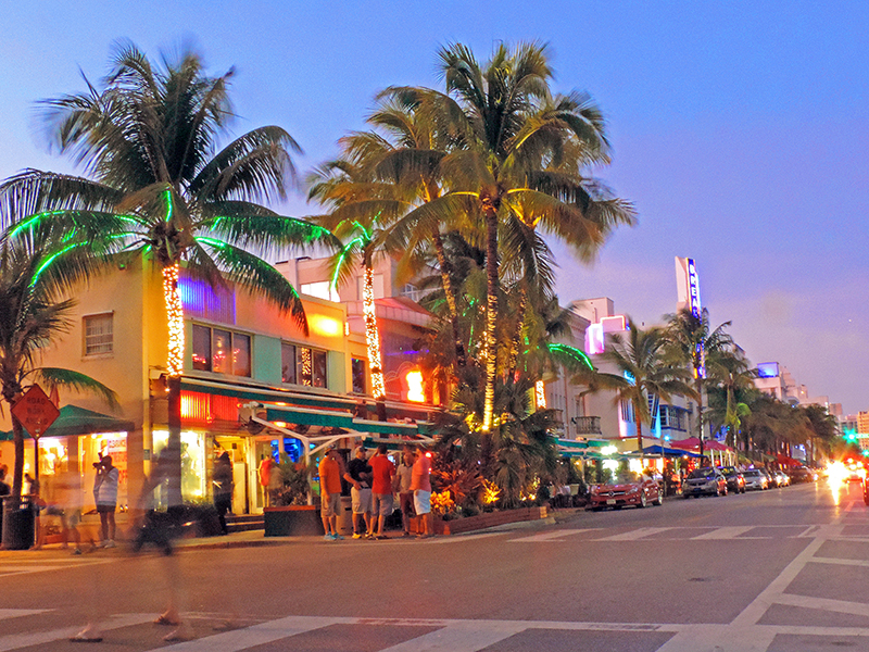 people on the street in South beach, one of the places to stay and one of Miami's attractions