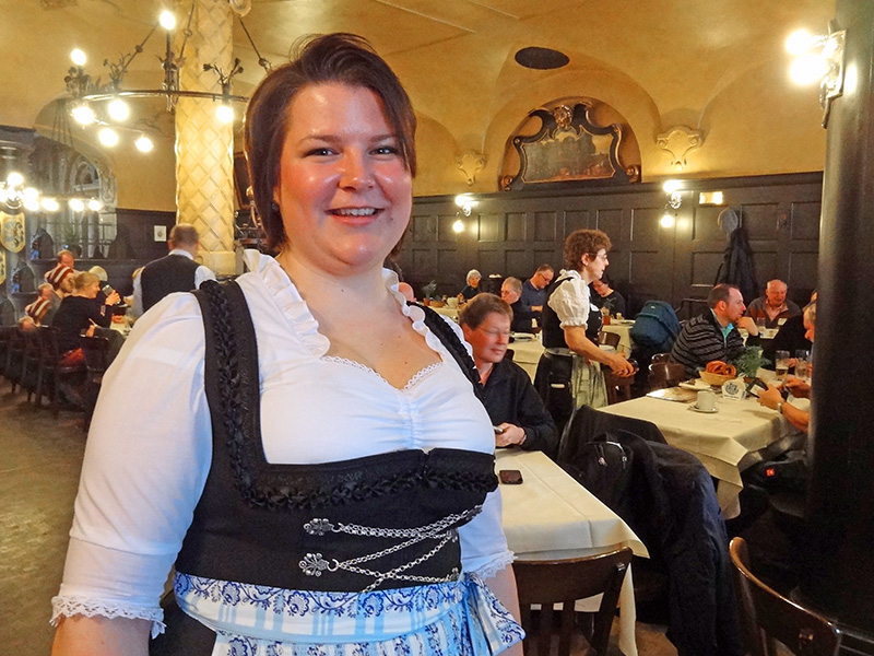 A waitress in a dirndl at a Munich beerhall