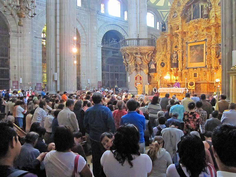 people in the cathedral in the Zocalo, Mexico City