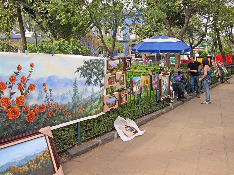 people in an art fair in a park in San Angel, Mexico City