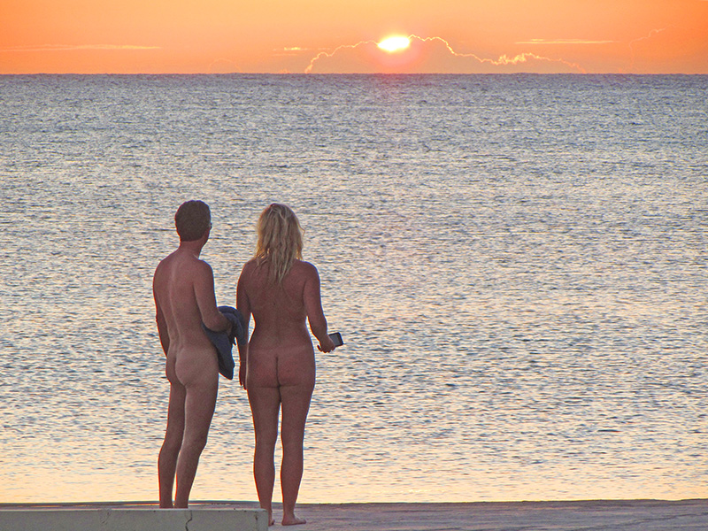 a nude couple watching the sunset at Hedonism II in Negril, Jamaica