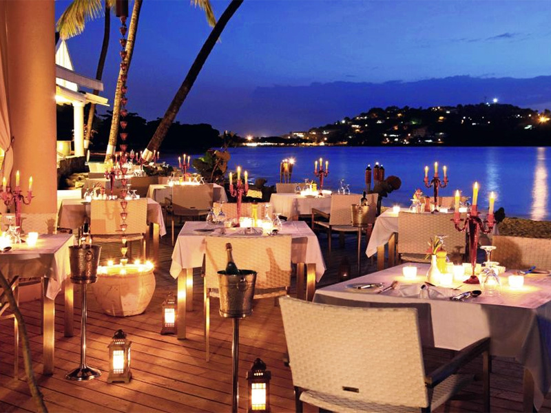 an outdoor dining room at a luxury St Lucia accomodation