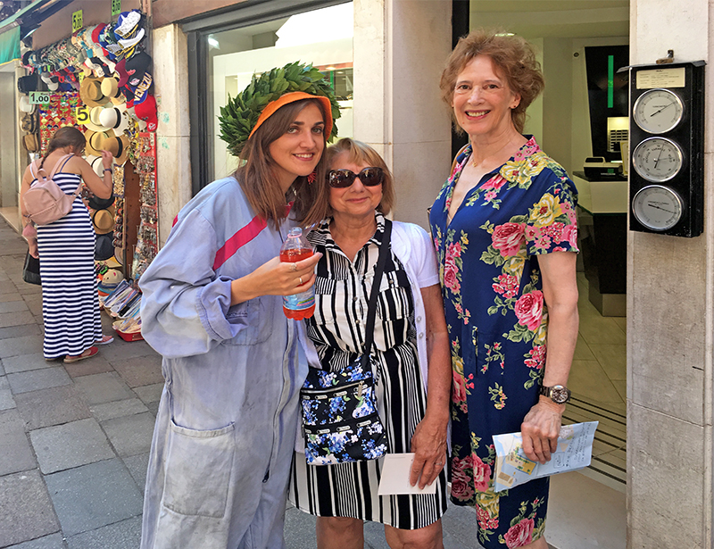 two women traveling meeting a new friend in Italy