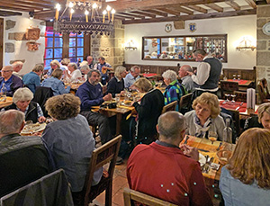 people in a restaurant in a Mont St. Michel hotel