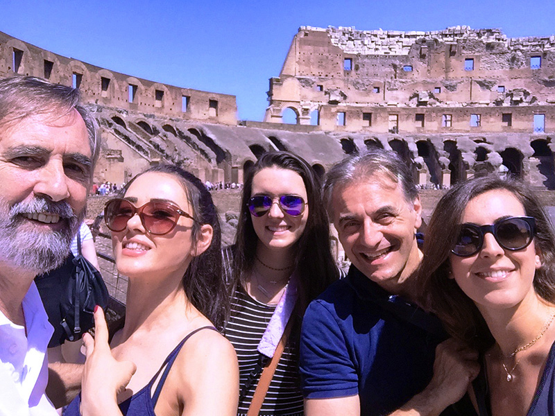 a group photo in the Coloseum, one of the places to visit in Rome