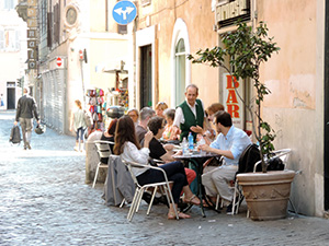 people at an outdoor restaurant in Rome