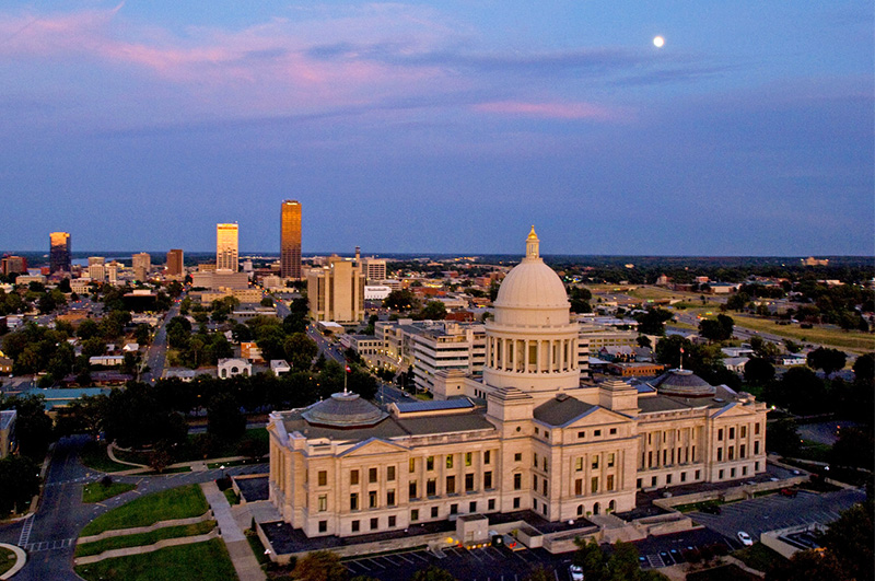 a state capitol building at dusk