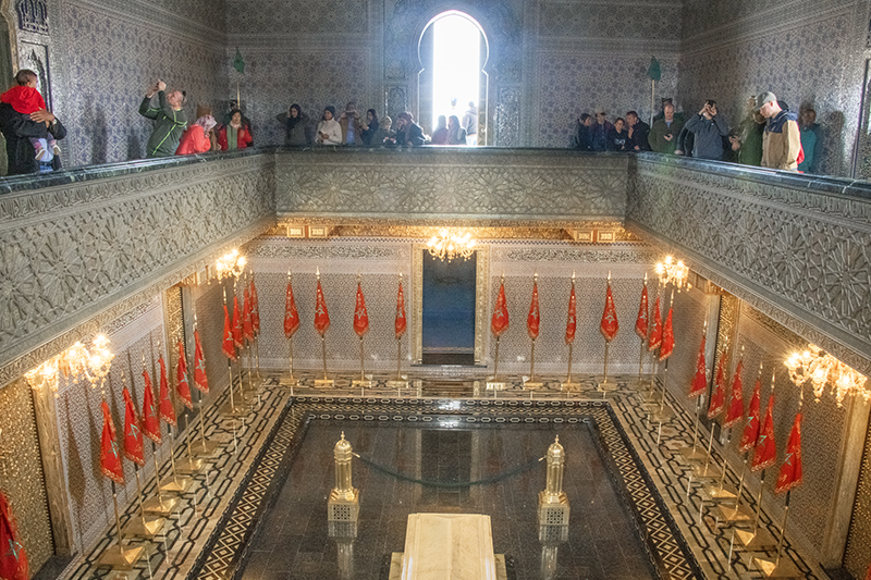 Visitors in the King's mausoleum, one of the places to visit in Morocco